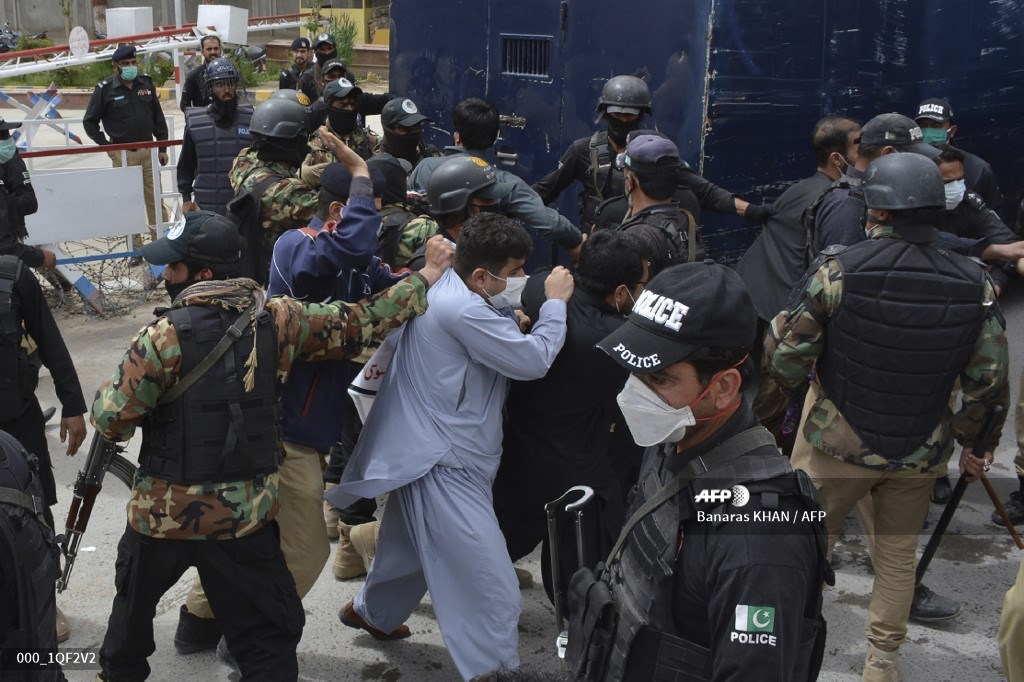 One of the saddest protest pictures we've ever seen. Doctors in Pakistan, desperate for PPE, clashing with the police. Another virus out-of-control is militarism.
