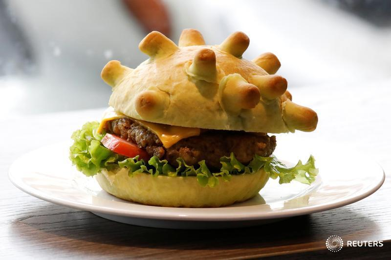 Meet the Hanoi chef who is attempting to boost morale in the Vietnamese capital by selling green, coronavirus-themed burgers https://reut.rs/2Uk621S Follow the latest news on coronavirus with our live blog: https://reut.rs/3aw35Bb