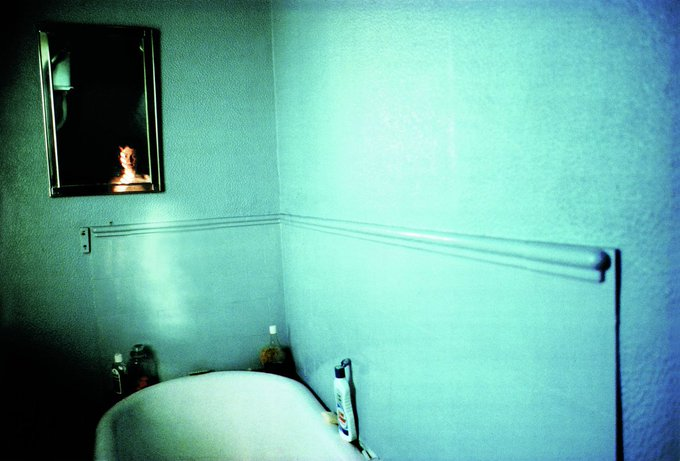 US photographer Nan Goldin, Self-portrait in blue bathroom, London, 1980 #womensart