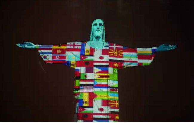 #Brazil's #Christ the Redeemer statue lights up with the flags of countries hit by #coronaviruspic.twitter.com/6f7YFZgwWE