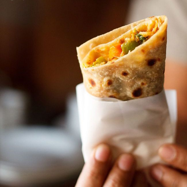 Dive into the deliciousness of Indian food at Vaades! A Indian Burritos (Kathi Roll) is one dish we would totally suggest! 👍👍👍 Just visit  & PLACE YOUR ORDER.  . #foodies #tastyfood #deliciousfood #KathiRoll #IndianBurritos #VaadesRestaurant