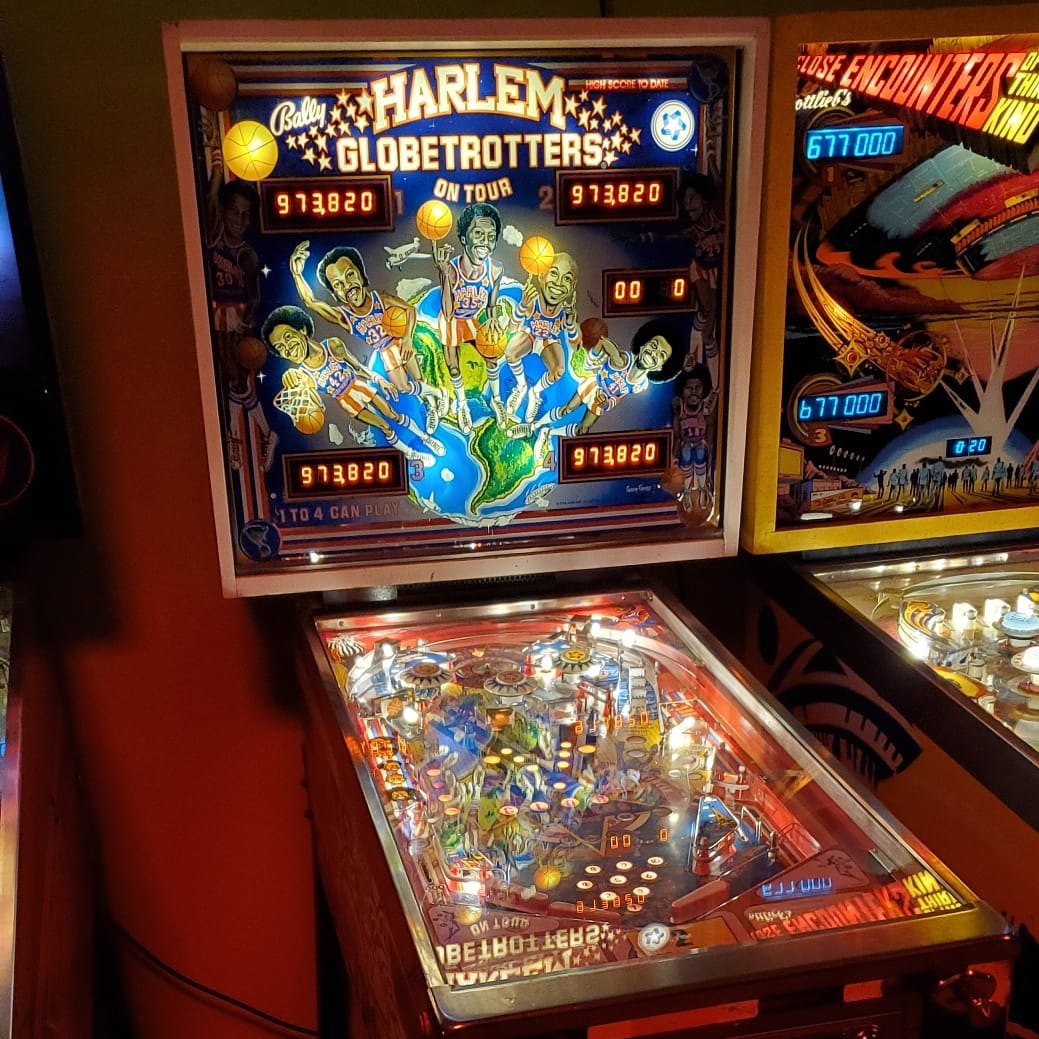 "We were sad to hear that Fred ""Curly"" Neal passed away this week. Tribute to he and teammates will always be the Harlem Globetrotters on Tour pinball. Designed by Greg Kmiec, art by Greg Freres and released in 1979 by Bally with just over 14,500 units produced. #arcademuseum"