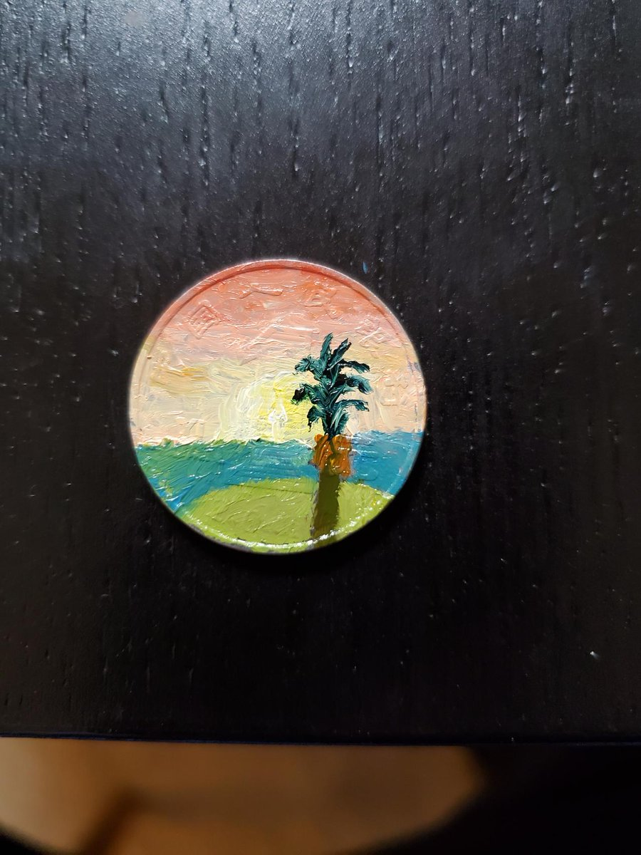 It's a tiny island in the sunset, on a coin.   #paint pic.twitter.com/rXpCKbyiKD
