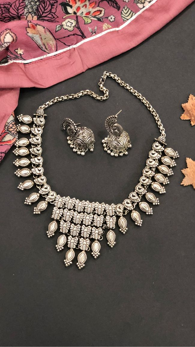 Oxidized Designer Necklace with Peacock Jhumkas!  Click on http://bit.ly/33ryAtq  to Download Ruvvy App and get your hands on more amazing products!  #Ruvvy #RuvvyJewellery #Jewellery #Necklace #earrings #Jewelleryset #LiveVideoShoppingpic.twitter.com/3j6vKT0fF1