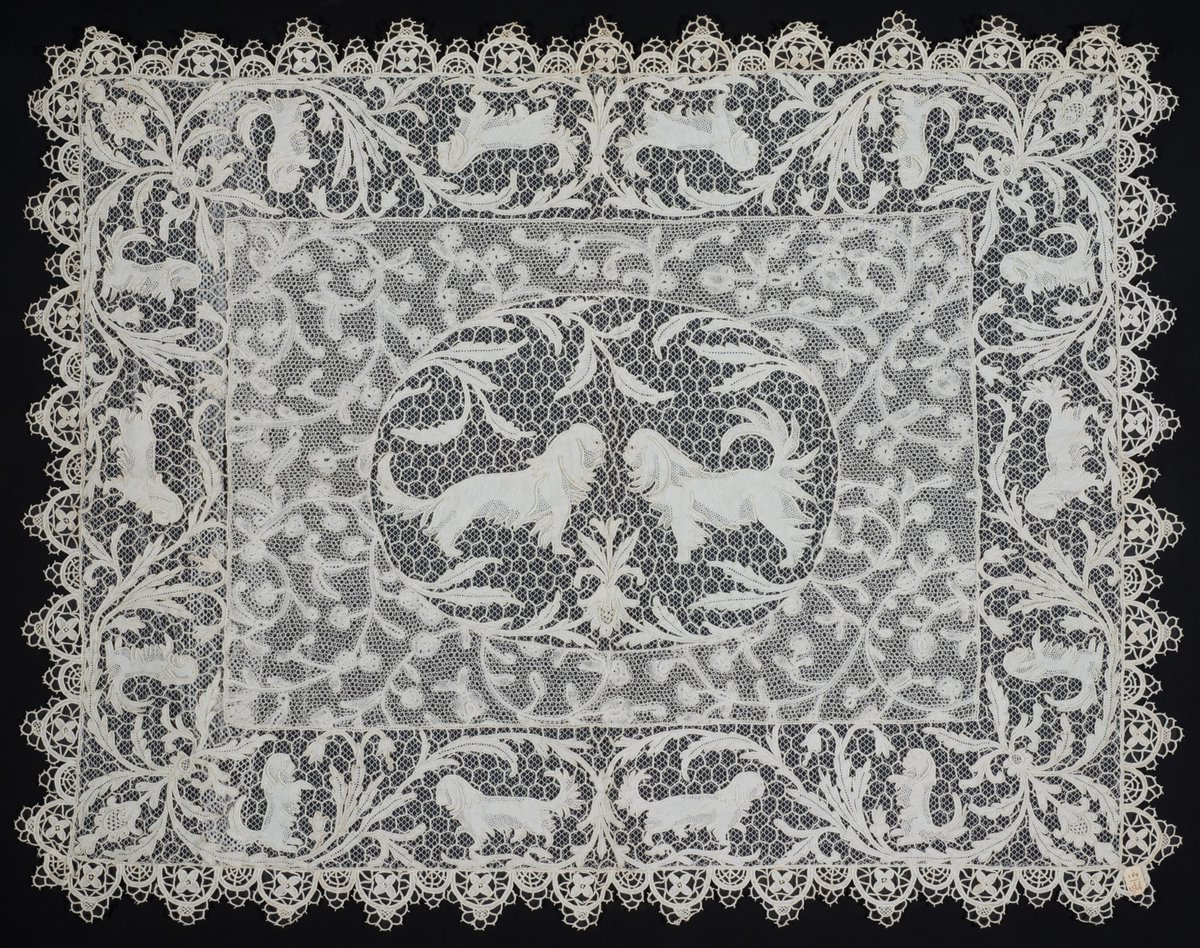 Let's keep talking pets, shall we?  This piece of War Lace (made of both needle lace and bobbin lace) was made around 1916, presumably in Opbrakel, Belgium.  It shows Pekinese dogs in several postures. Pekinese dogs were typical companion dogs in this period.  #Museumathome https://t.co/YgauTM2Fnw