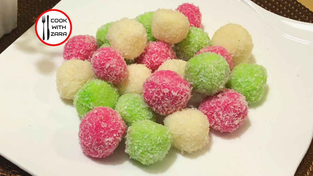 Coconut Ice Snowballs | Coconut Balls Recipe By COOK WITH ZARA   #coconutballs #coconutsnowballs #coconut #sweet #coconutsweet #coconuticesnowballs #cookwithzarapk #StayHome #StaySafe