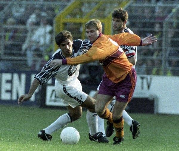 📷 FLASHBACK: Motherwell striker Tommy Coyne gets away from Borussia Dortmund's Karl-Heinz Riedle during a UEFA Cup tie in Westfalenstadion in September 1994