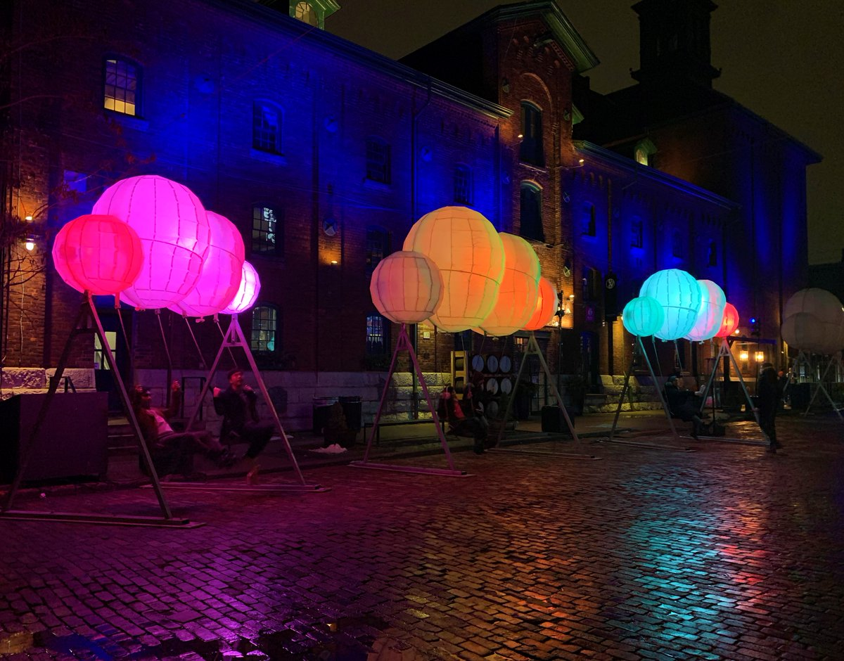 "LOVED this colourful, interactive piece at @tolightfest In the Distillery District! So whimsical and pretty! ""Cloud Swing"" by @lindsayglatz & Curious Form Studio (Photo I took in January) 📷🎨 💡💙☁️ #tolightfest #distillerydistrict #citylights #art #publicart #Torontolife"