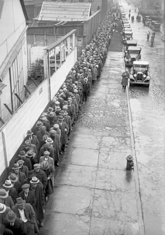 Jobless men wait in line to be served with Christmas dinner at the Municipal Lodging House, New York City, 1932.