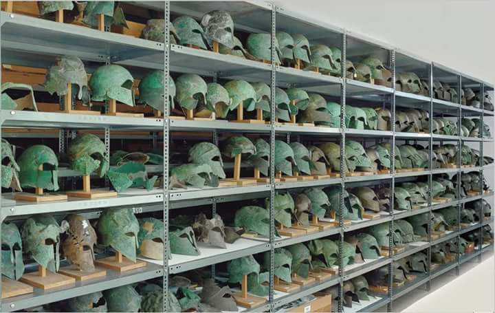 Greek Corinthian helmets from the Classical period, stored in the Arch.Museum of Olympia,Greece.