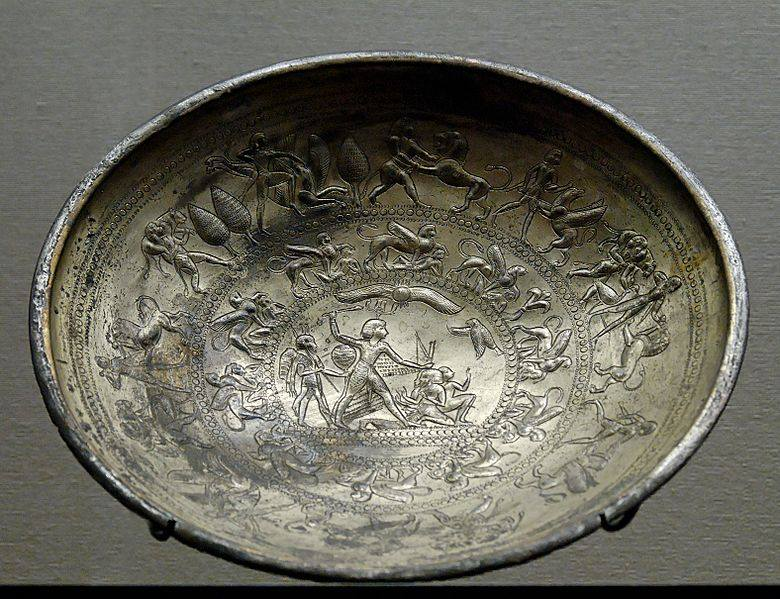 Bowl with mythological scenes a Spinx frieze and the representation of a king vanquishing his enemies.Electrum.Archaic period 8th-7th c.BC.From Idalion,Cyprus.