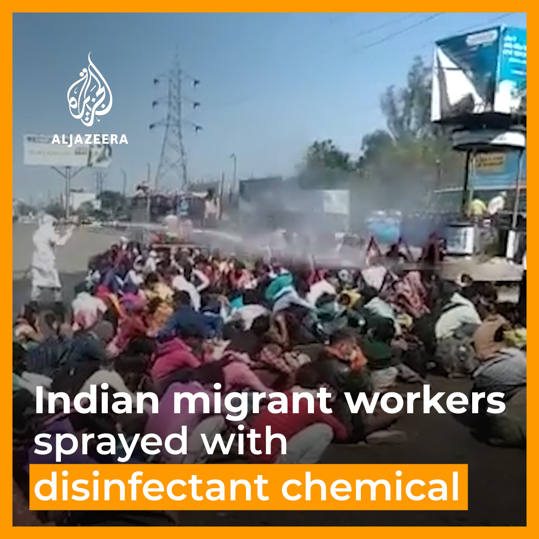 In this video, groups of migrant workers in India are being sprayed with chemical disinfectant, sparking outrage.