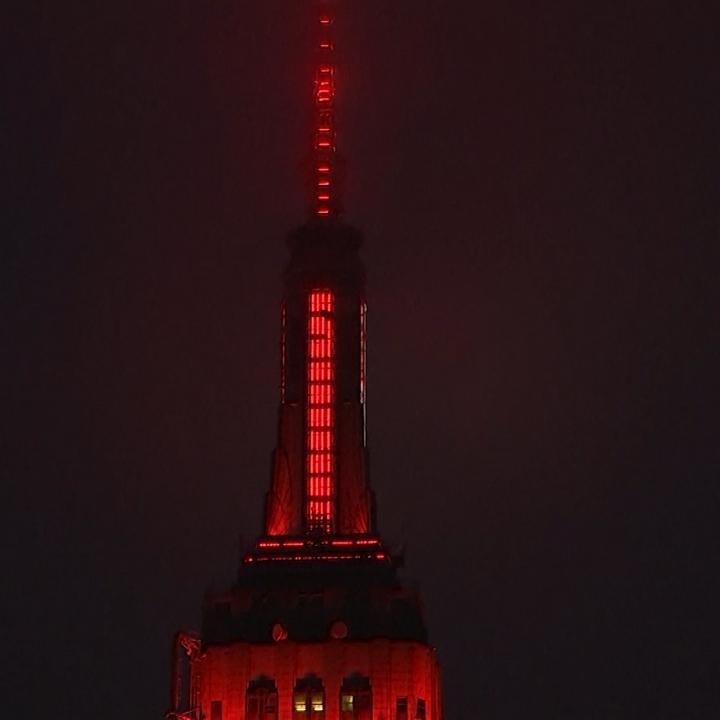 New York's Empire State Building was lit up like an ambulance Monday night in honor of first responders and medical professionals on the front lines of the city's coronavirus outbreak