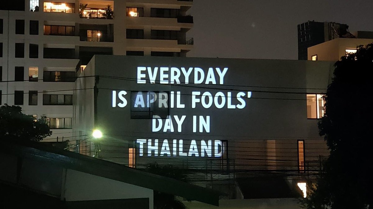 "Following the news that the Thai government has banned April's Fool Day, this was spotted on the side of a building in Bangkok: ""Every day is April Fools' Day in Thailand"". This image was posted on the Facebook page of Thai activist Dudeswee #Bangkok #Thailand #COVID19pic.twitter.com/nbVVtTPejv"