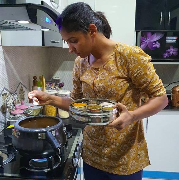 Harmanpreet Kaur trying a new dish. PC: Twitter