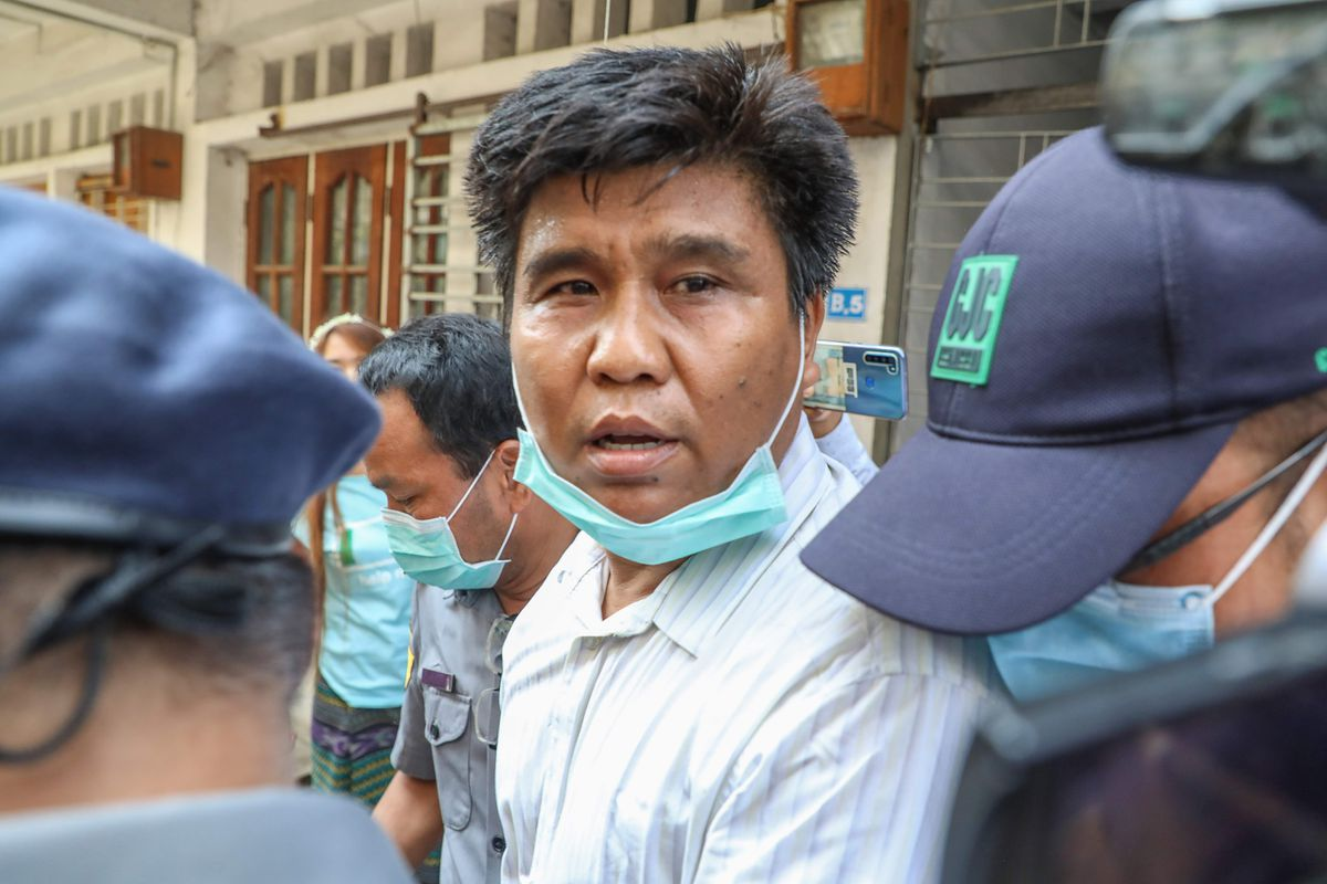 Myanmar court charges journalist under terrorism law, blocks news websites