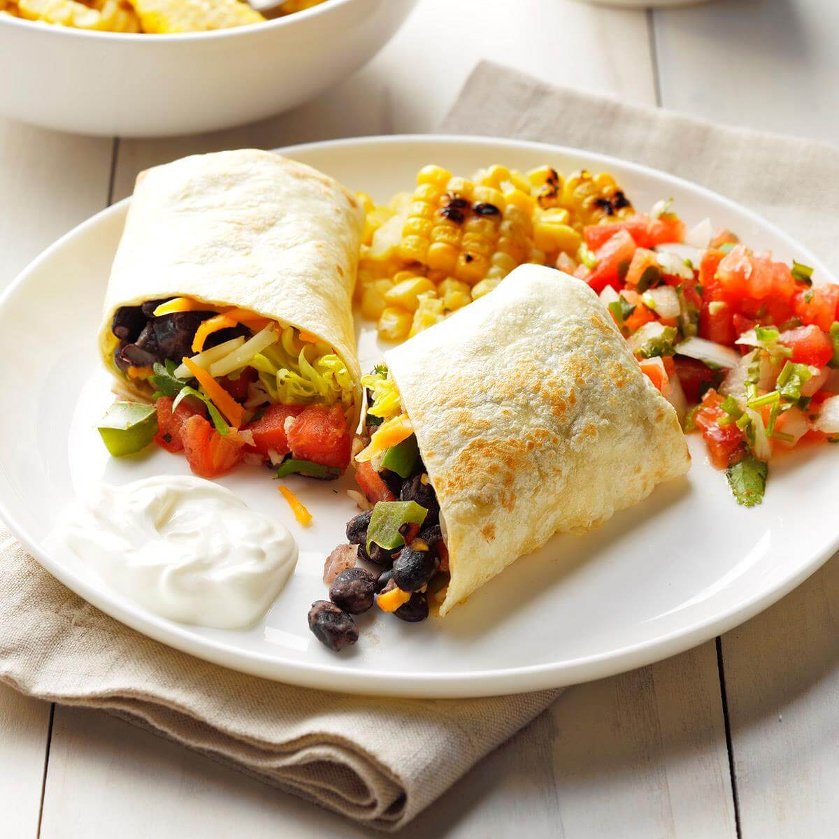 BLACK BEAN BURRITO  The combination of Southwestern ingredients and Eastern seasonings add a unique flavor to this burrito. Enjoy!  Head on to our Instagram @ahealthyview to get the full recipe  #keepinghealthy #kitchenrecipes #EatDrinkAndStillShrink #foodislove