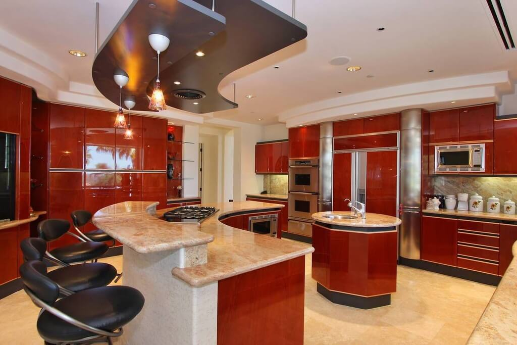 What do you think of this kitchen design with unique angles & glossy cabinets?  Coastal Virginia Magazine's Best Kitchen & Bathroom Remodeler#dogoodwork #kitchendesign #hgtv #kitchen #bathroom #homeimprovement #home #remodeling #remodel