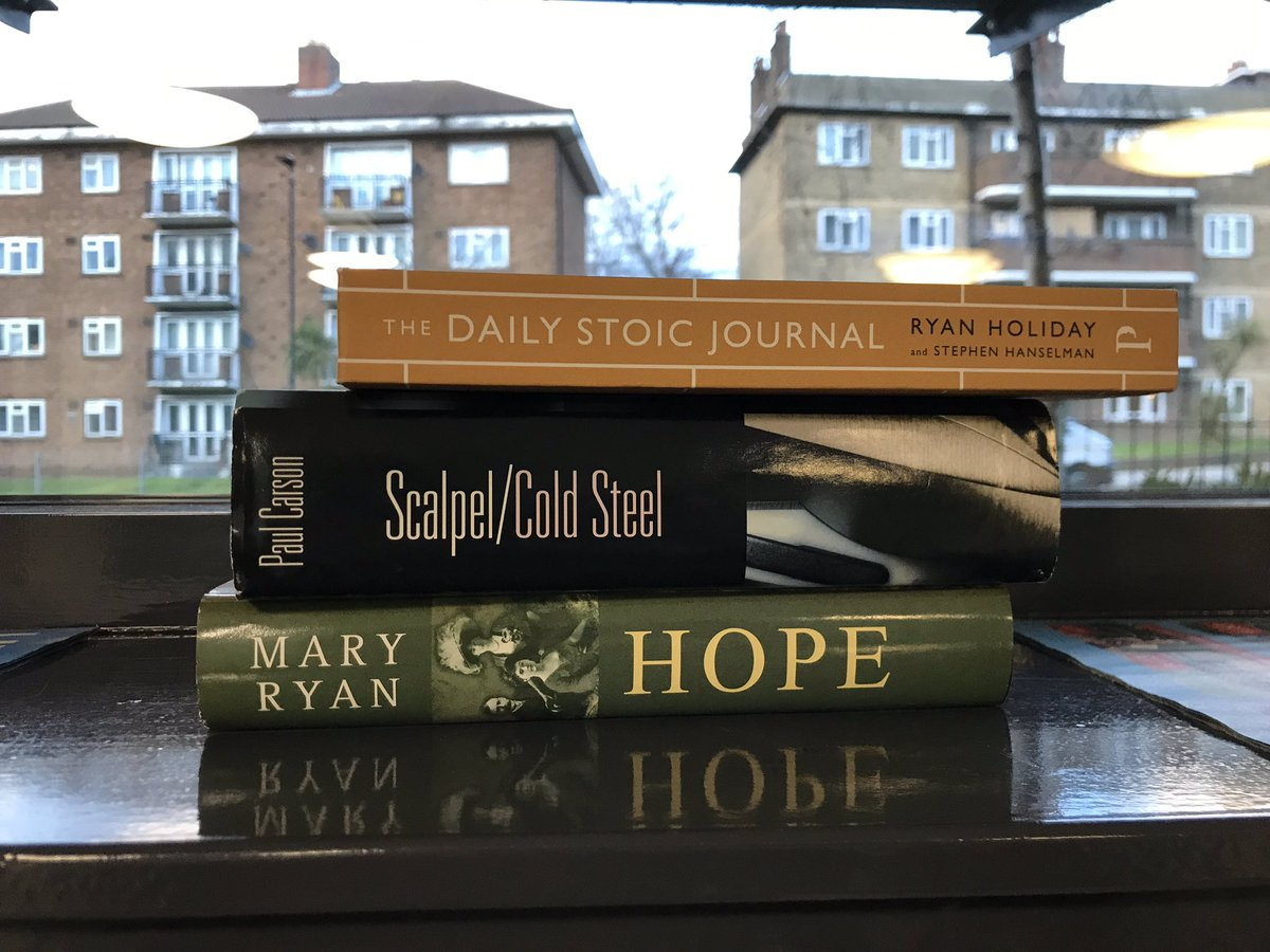 These books have appeared in this order in the entrance of my block of flats - someone has a grim sense of humour