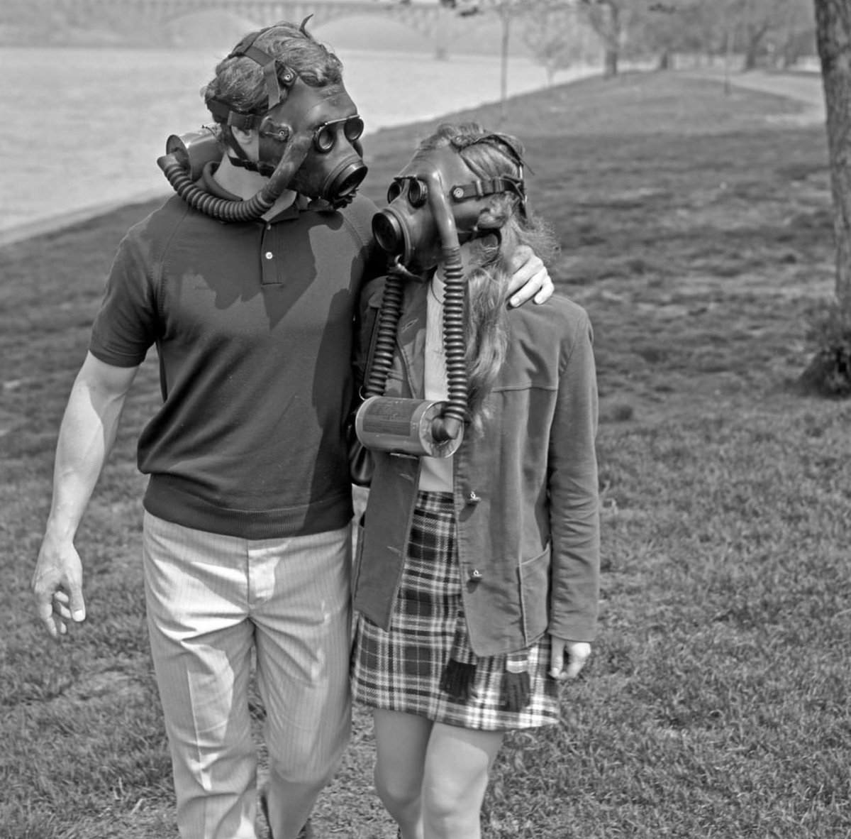 A couple making a point about smog and the environment. 1970, Photo by H. Armstrong⠀