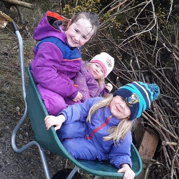 Getting ready for our Easter bonfire. Happy little ladies. Good to get outdoors:)
