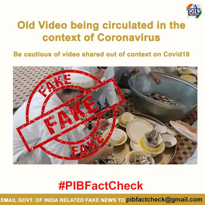 A stamp of  'FAKE' on a video grab claiming people are spreading coronavirus infection in India by licking cutlery.