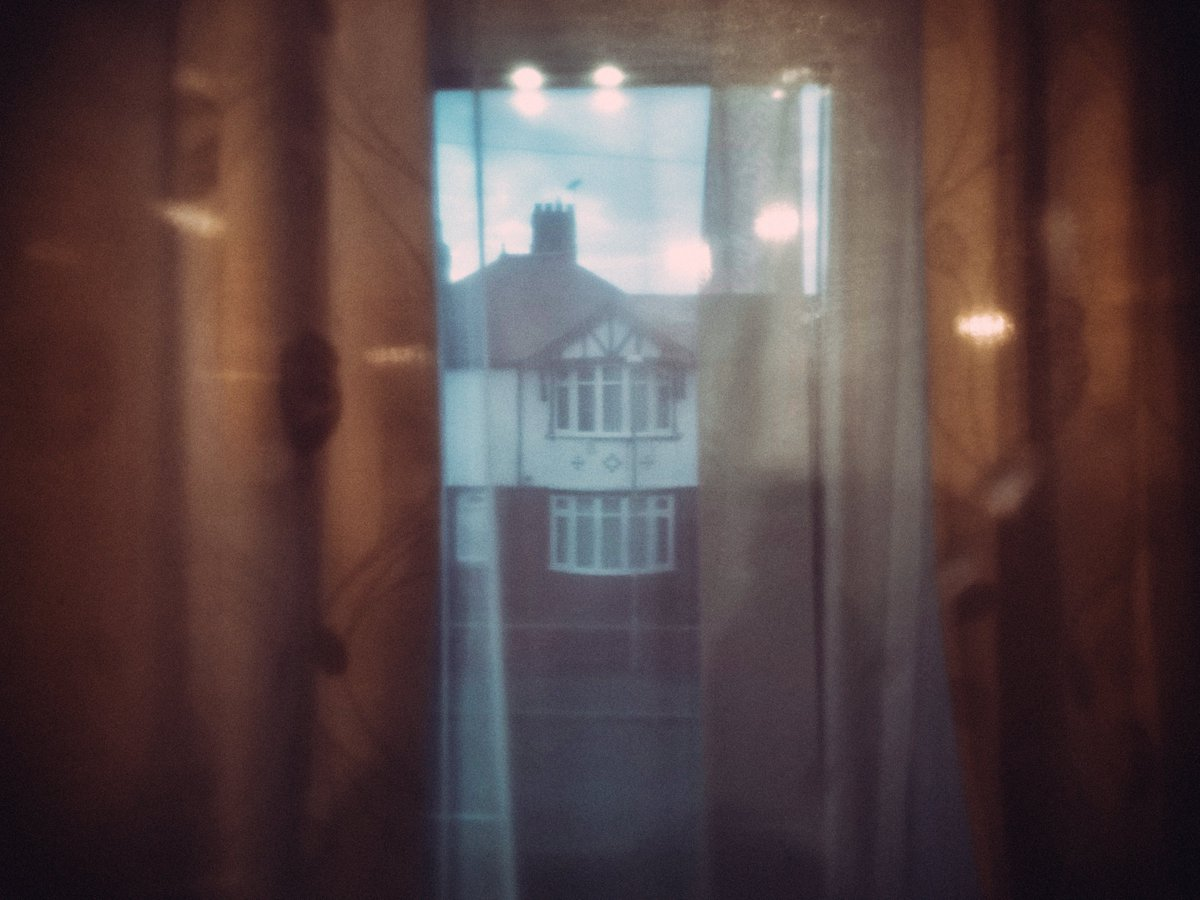 In The Time Of Covid - Through The Window #colour #light #dark #urban #urbanwales #art #artphotography #mood #mystery #atmosphere #strange #cinematic #cinematicstill #experimental #bokeh #lensflare #distortion #dream #dreampop #couldbeanalbumcover #home #rhylpic.twitter.com/eVYZcOE6LN