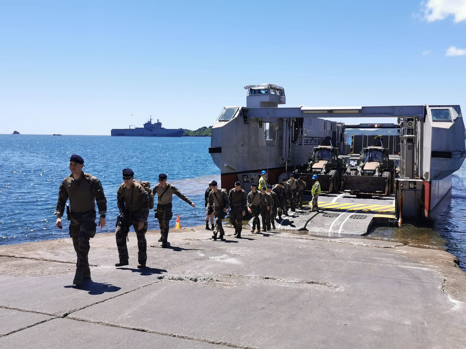 Soldiers exiting EDA-R catamaran landing craft (L-CAT) on Mayotte. Mistral can be seen in the background. French Navy Photo.