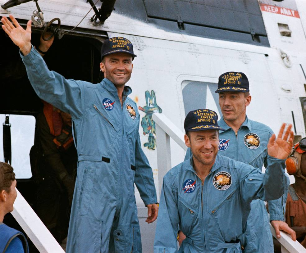 Apollo 13 crew waves after boarding recovery ship