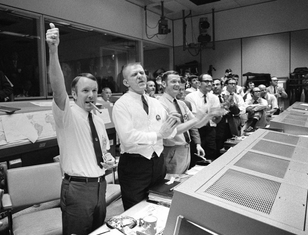 Mission Control flight controllers celebrate