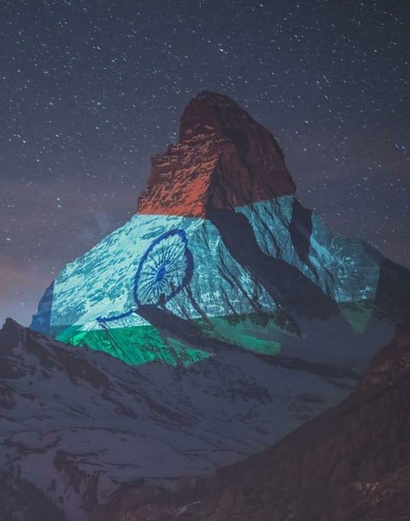Switzerland's most famous mountain - the #ZermattMatterhorn lit up in the glorious Indian Tricolour. A message of solidarity and hope... A tribute to the indomitable human spirit Red heart🙏🏽Nazar amulet Light Art by #GerryHofstetter and Camera with flash #GabrielPerren