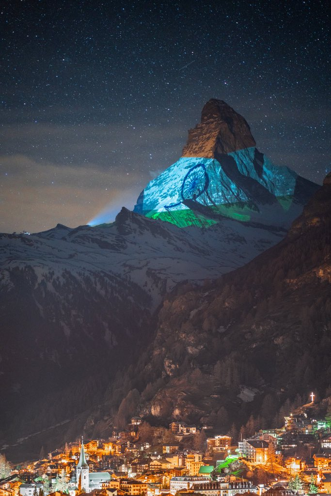 Switzerland's most famous mountain - the #ZermattMatterhorn lit up in the glorious Indian Tricolour. A message of hope and strength as world fights Chinese Virus Pandemic!  Light Art by #GerryHofstetter and Photographed by #GabrielPerren   @zermatt_tourism