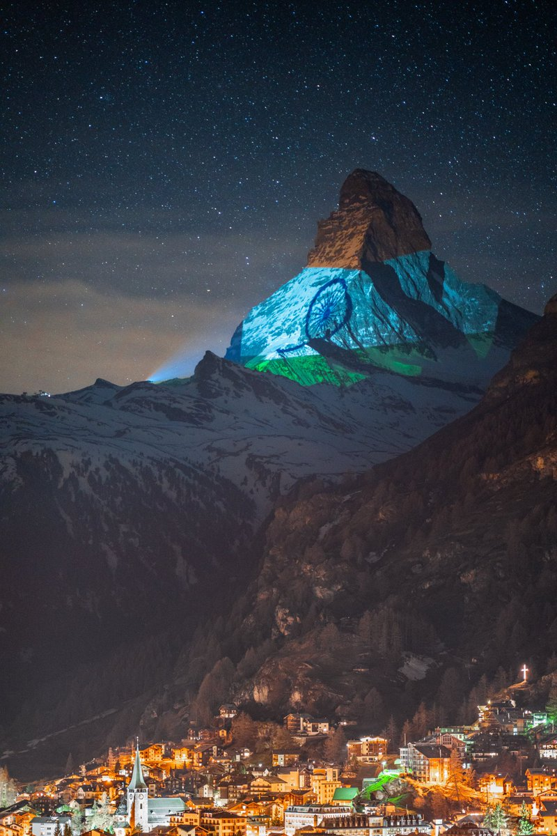 Switzerland's most famous mountain - the #ZermattMatterhorn lit up in the glorious Indian Tricolour. A message of solidarity and hope.. A tribute to the indomitable human spirit ❤️🙏🏽🧿 Light Art by #GerryHofstetter and 📸 #GabrielPerren  #inlovewithswitzerland @MySwitzerlandIN 🤝