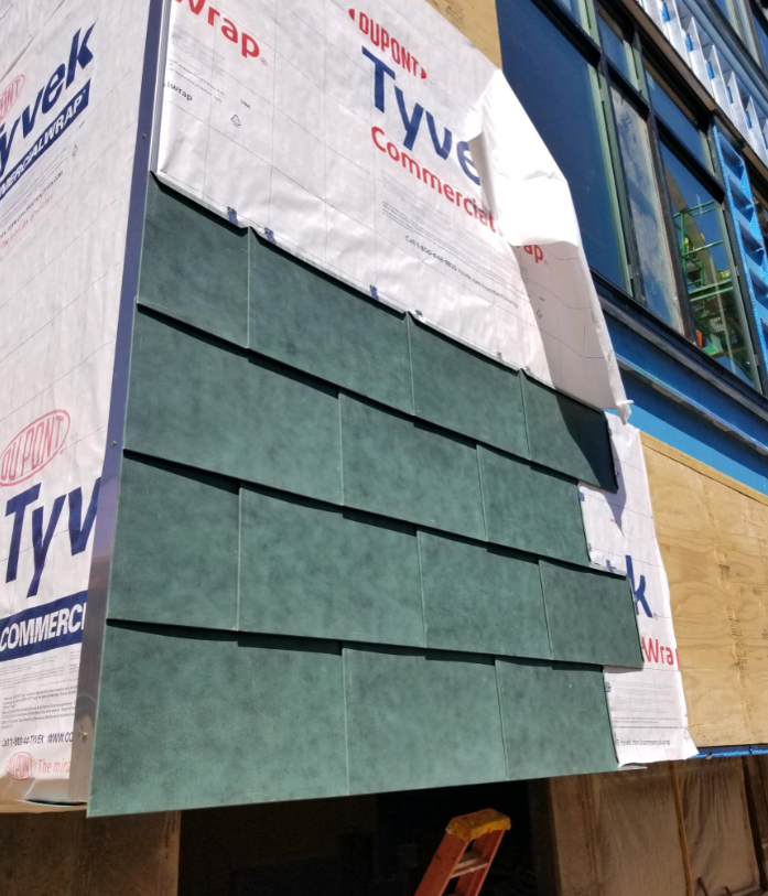 Copper siding started at <a target='_blank' href='http://twitter.com/DHMiddleAPS'>@DHMiddleAPS</a> addition! It's pre-patinated, or pre-weathered, meaning the chemical process to turn the panels from shiny to dull green occured in the factory.   <a target='_blank' href='http://twitter.com/APSscience'>@APSscience</a>- any resources about the process?  <a target='_blank' href='http://twitter.com/EllenSmithAPS'>@EllenSmithAPS</a> <a target='_blank' href='http://twitter.com/dhms_ptsa'>@dhms_ptsa</a> <a target='_blank' href='http://search.twitter.com/search?q=StratfordProject'><a target='_blank' href='https://twitter.com/hashtag/StratfordProject?src=hash'>#StratfordProject</a></a> <a target='_blank' href='https://t.co/NdCMJtFwAH'>https://t.co/NdCMJtFwAH</a>