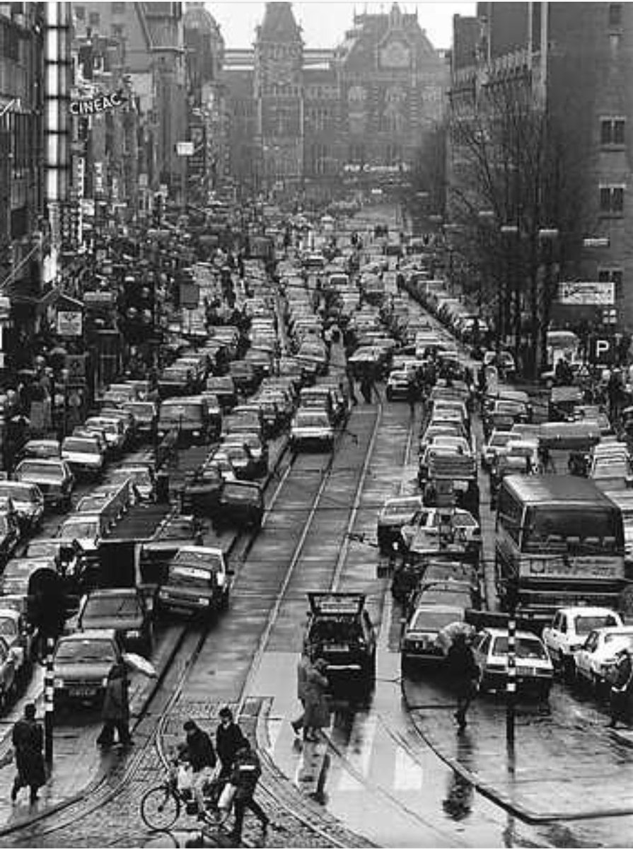 """If anyone says """"We are not Amsterdam. We can't do that. We are different"""" then show them this pic of  Damrak, Amsterdam 1970s-2010s & say """"Neither was #Amsterdam!"""". City transformation takes many things but above all it takes deliberate, committed leadership. Pic @fietsprofessorpic.twitter.com/f55FrVwnuC"""
