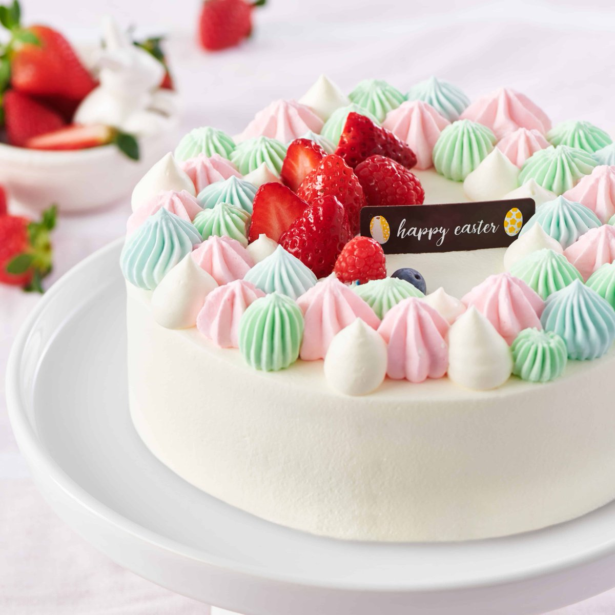 Sweet Strawberry Easter Cake! Strawberries, Soft Cream, and three layers of Vanilla Cake... The perfect Easter treat! #EasterCake #Cake #parisbaguette #bakery #dessert Available only at select locations.
