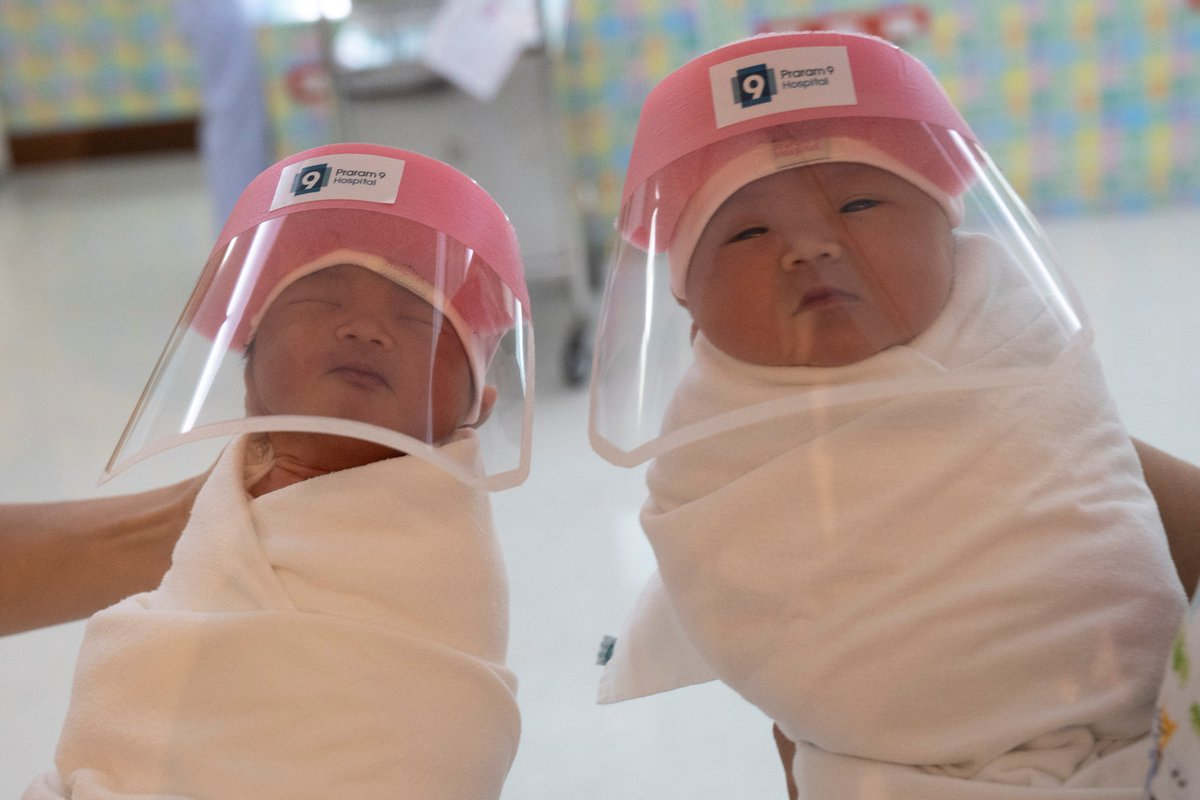 Nurses hold newborn babies wearing protective face shields during the #COVID19 outbreak at the Praram 9 hospital in Bangkok, Thailand | via Athit Perawongmetha, @Reuterspic.twitter.com/RVbWgrkMmd