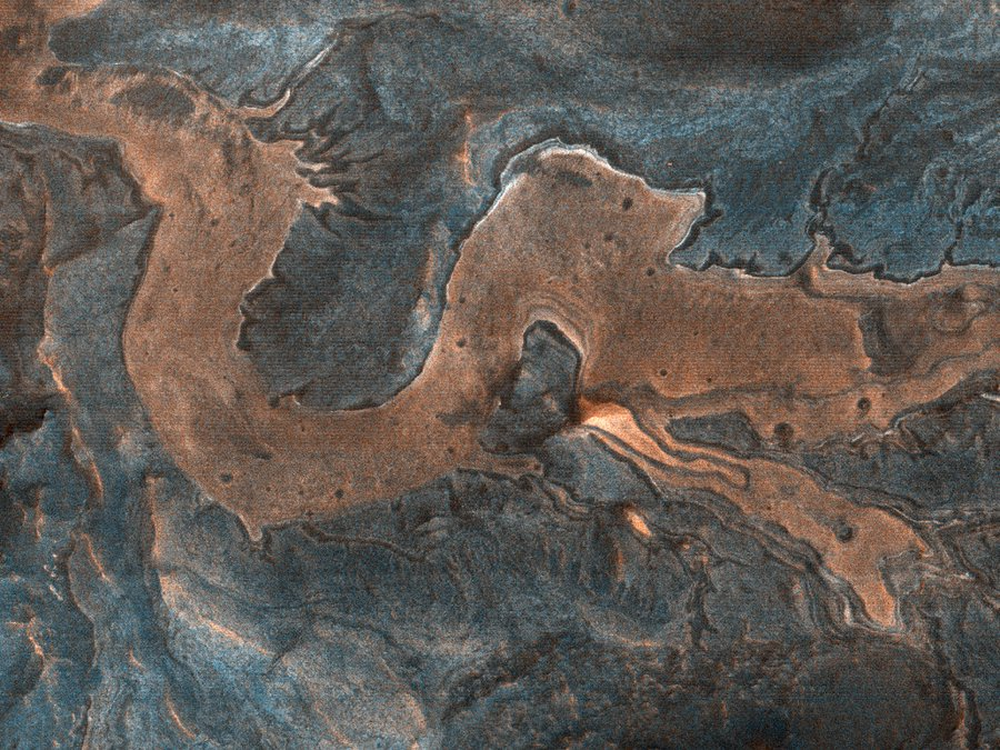 An image of light-toned blocky material in southwestern Melas Chasma that from one perspective, looks like a Chinese dragon. (NASA/UArizona)