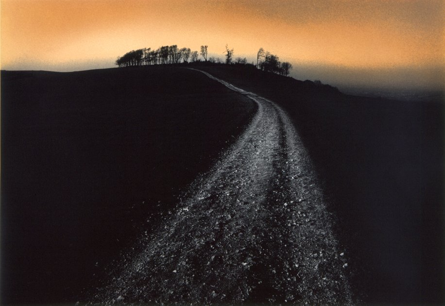 Heres one of Peters shots of Chanctonbury Ring at dusk. Its a hand-toned, silver gelatin photo. #chanctonburyring #sussex #ancientsites