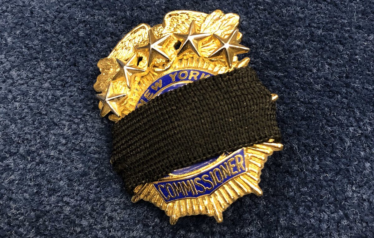 New Yorkers may begin to see our officers with black mourning bands across their shields—and across their hearts. We wear these in quiet commemoration of our 27 brothers and sisters we've lost to #COVID.  Another way we honor our vow to #NeverForget.