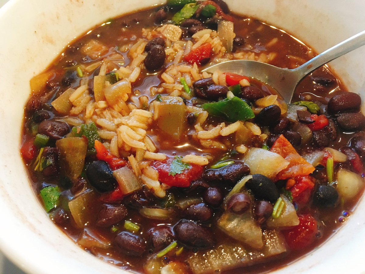 This vegetarian black bean chili I made is damn good. Served on rice.