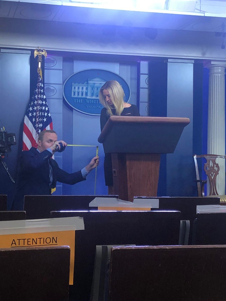 WH officials measuring lectern for new press secretary. Photo by @nikkicarvajal
