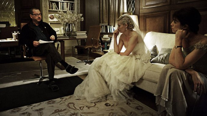 Lars Von Trier and Kirsten Dunst on the set of Melancholia (2011)  happy birthday to these two legends