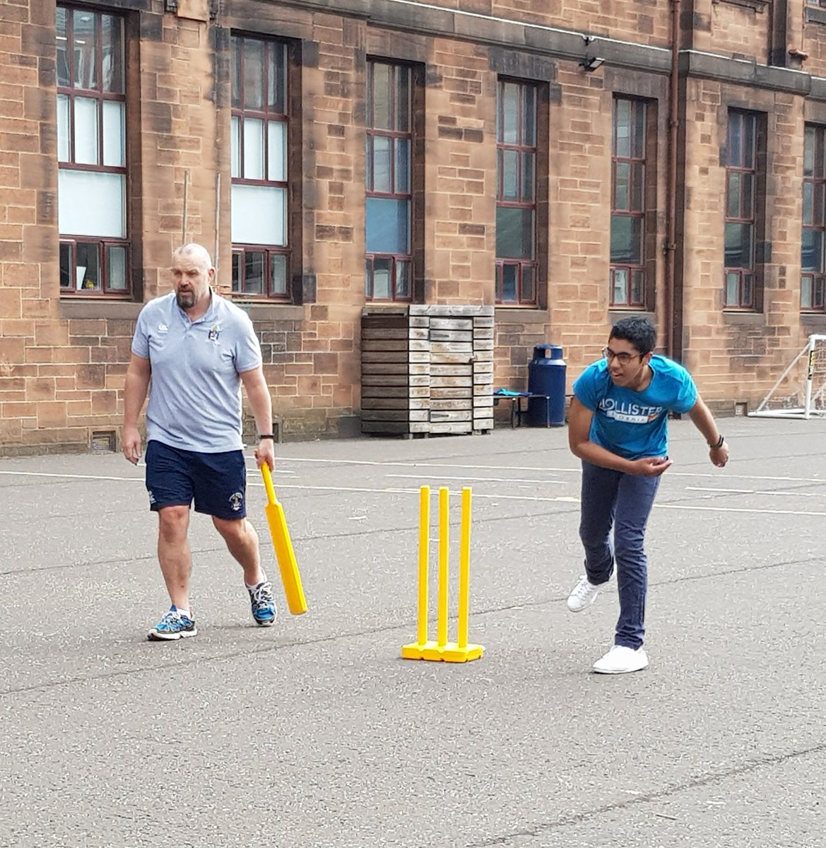 The key worker children enjoyed a game of cricket with Mr Dewar in the playground today. #WeAreHutchie https://t.co/64roaOMJJw
