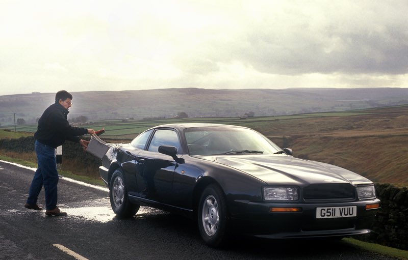 Rowan S Virage On Twitter Here Is A Photo Of Rowanatkinson With His Astonmartin Virage From 1990 He Stopped At The Side Of The Road To Give The Car A Quick Clean For