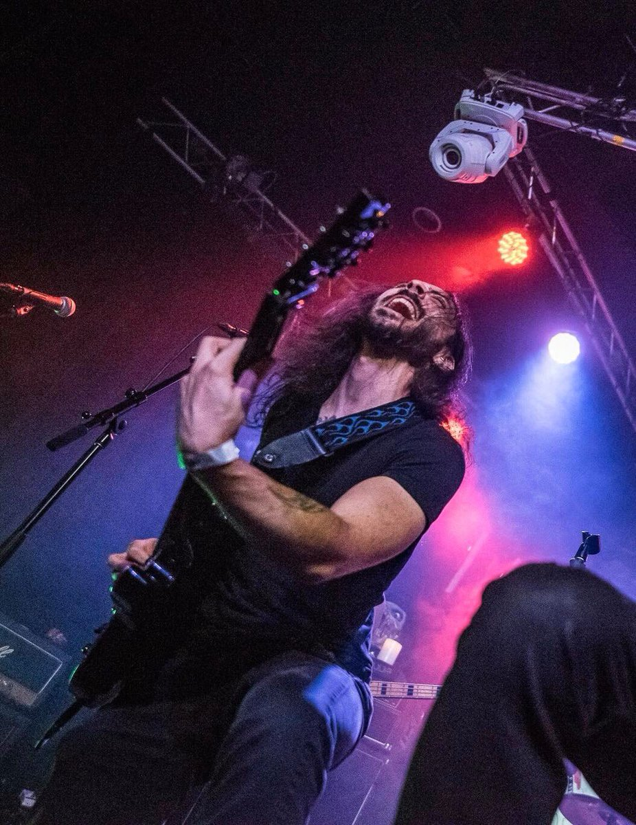 Can't tell if I'm sneezing, stepping on a Lego brick, or enjoying myself. Maybe all three at once?   Photo: @byeboston   #purplelight #schecterhellraiser #guitarplayersunite #guitarplayersdaily #metalface #liveguitarpic.twitter.com/oiHvlQpbrI