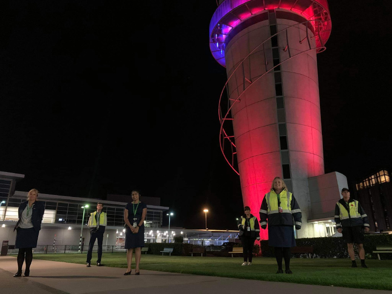 Essential airport staff paying an essential tribute at dawn. Lest We Forget. #StandAtDawn #WeWillRememberThem