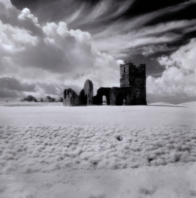 Back down south again for Peter Greenhalfs Knowlton Henge. Its another infrared, silver gelatin photograph with a really trippy sky. #knowltonhenge #infrared #silvergelatin
