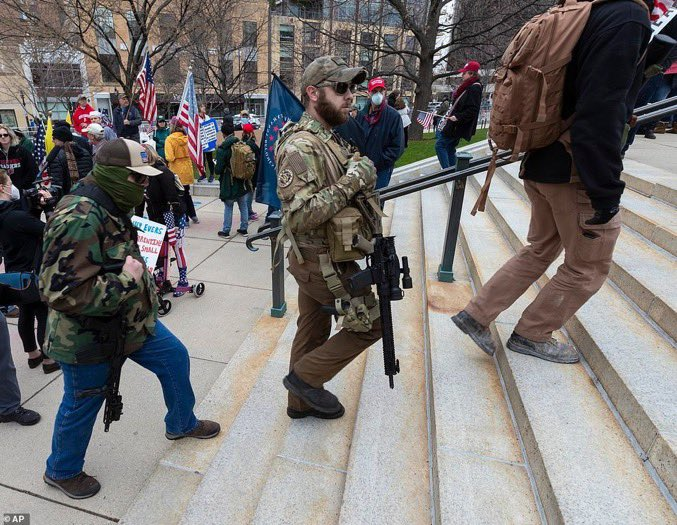 "From the stay-at-home orders ""protest"" yesterday in Madison, Wisconsin: The obligatory camouflage, long guns, and a makeshift guillotine, all routinely trotted out by gun extremists across the US to threaten lawmakers' lives. #wileg https://t.co/07jJc6orXK"
