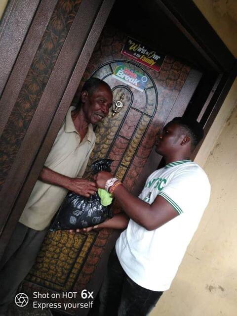 NYSC member, Osita Anthony Agiliga shares food to the elderly